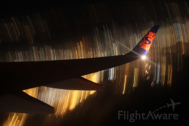 Boeing 737-700 (N714SY) - Sorry about the blurriness! This was my first time at night photgraphy from the plane