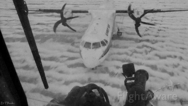 C-FIQR — - Snow covered ground and bent props, shot from the deice bucket