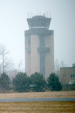 — — - Control tower as the snow apporaches