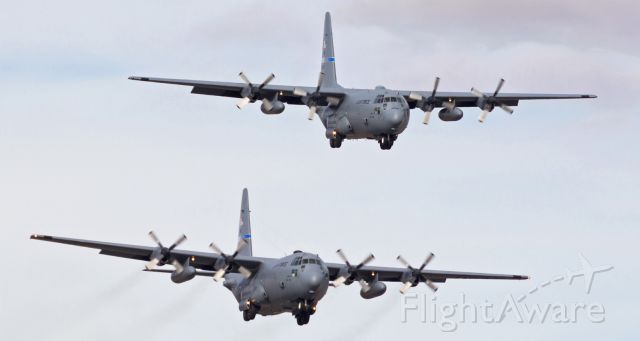 Lockheed C-130 Hercules (79-0478) - A pair of (former) Nevada Air Guard C-130H Hercs (79-0477 and 79-0478) are viewed here on very short final for runways 16R and 16L in this 2013 photo.<br />Both of these Hercs are now gone.  In 2015, 79-0477 (top) was with the Montana ANG and 79-0478 was written off as destroyed after an accident at Baghdad International Airport on 7 Jul 2015.