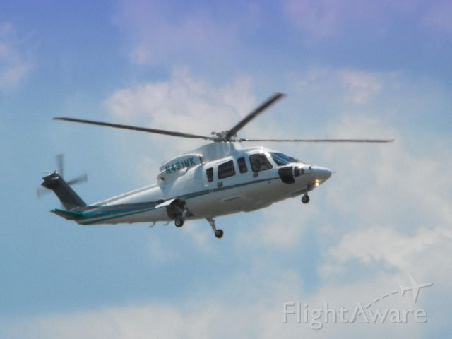 Sikorsky S-76 (N431MK) - Shown here in the Summer of 2014 this Sikorsky S-76C helo is a moment from landing.