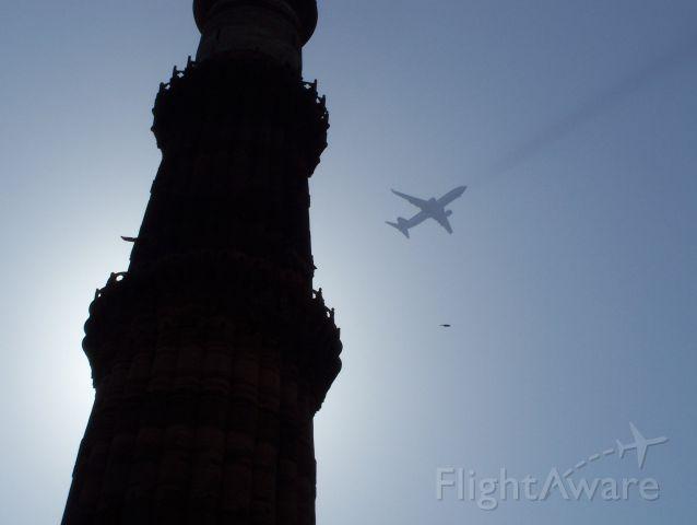 — — - Qutab minar Delhi India.  I couldnt read tail numbers etc.