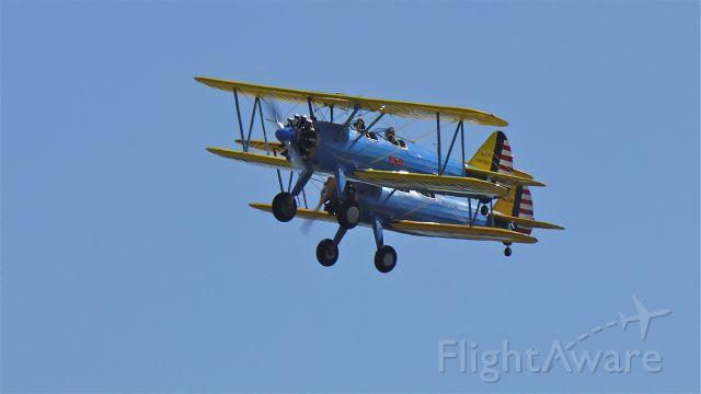 Boeing PT-17 Kaydet (N245PT) - Stearman PT17s N245PT & N68825 do a flyby at Vintage Aircraft Weekend. Photographed 9/3/11.