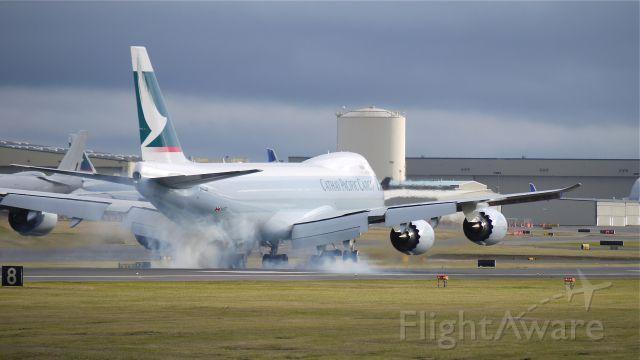 BOEING 747-8 (B-LJB) - Tire smoke! BOE552 touching down on runway 16R on 11/17/11.