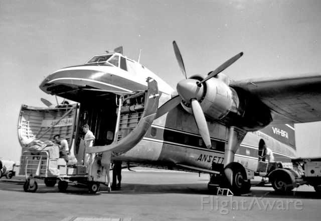 VH-BFA — - Nice posed study of loding crew at Adelaide in January 1962 from Geoff Goodall