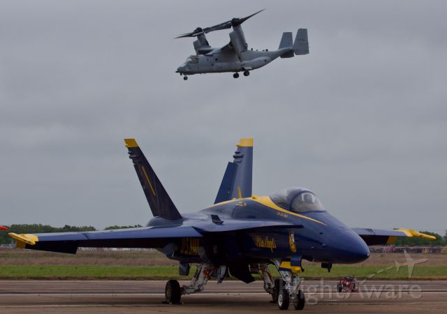 McDonnell Douglas FA-18 Hornet — - Blue Angel Lead sits patiently on the flight line as the USMC V-22 begins its demo flight at the 2018 Heart of Texas Airshow