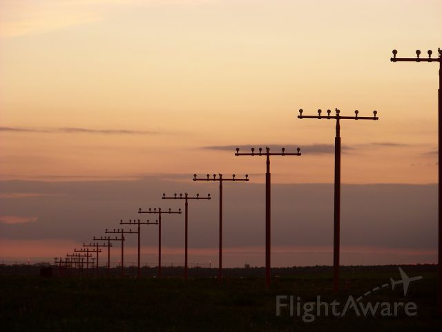 — — - Berlin Tegel runway on a September evening in 2011.