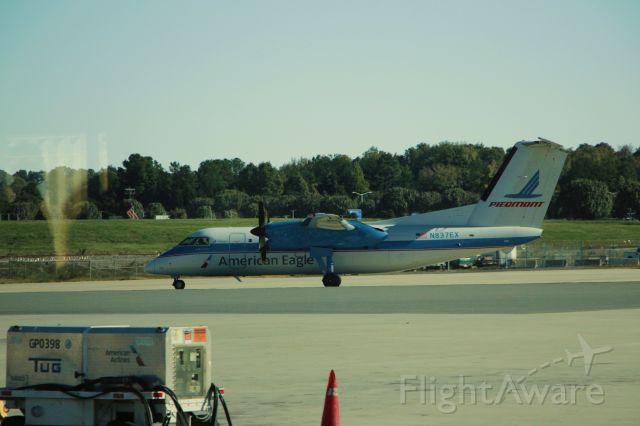 de Havilland Dash 8-100 (N837EX) - 10/22/16 inbound heritage painted commuter