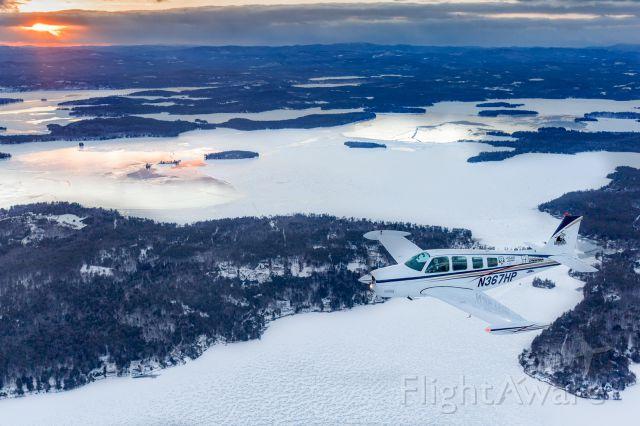 Beechcraft Bonanza (36) (N367HP) - Winter wonderland over Lake Winnipesaukee, NH.