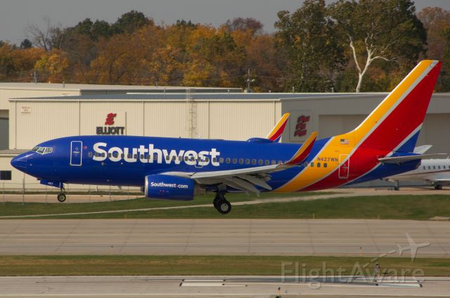 """Boeing 737-700 (N427WN) - The beautiful fall colors match very nicely with this Southwest 737-7H4 just crossing the """"23"""" marking before a late touchdown as SWA 1750 arriving in from Denver. Photo taken October 9, 2020 at 2:07 PM CDT with Nikon D3200 at 300mm."""