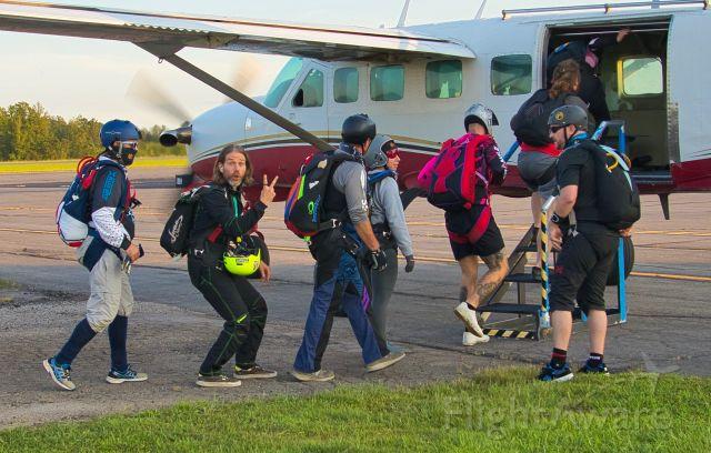 N694DA — - Skydivers step aboard a Caravan for a jump.