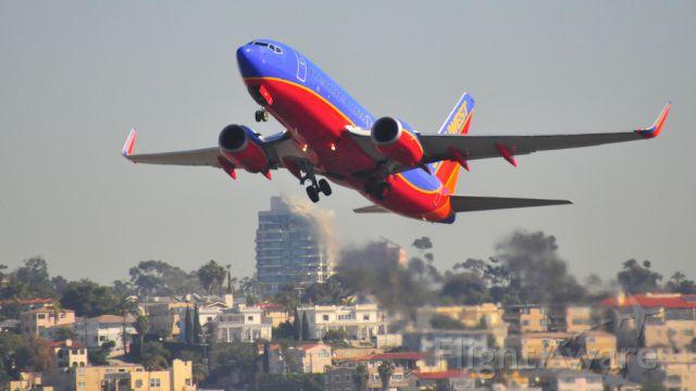 Boeing 737-700 — - Departing Runway 27 KSAN