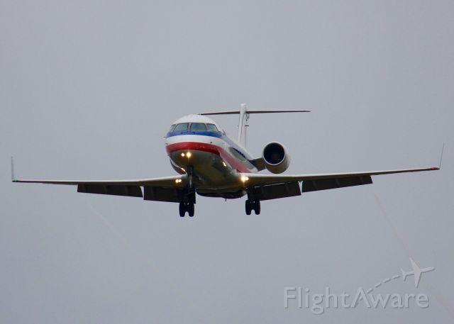 Canadair Regional Jet CRJ-200 (N879AS) - At Shreveport Regional. Landing in the rain.