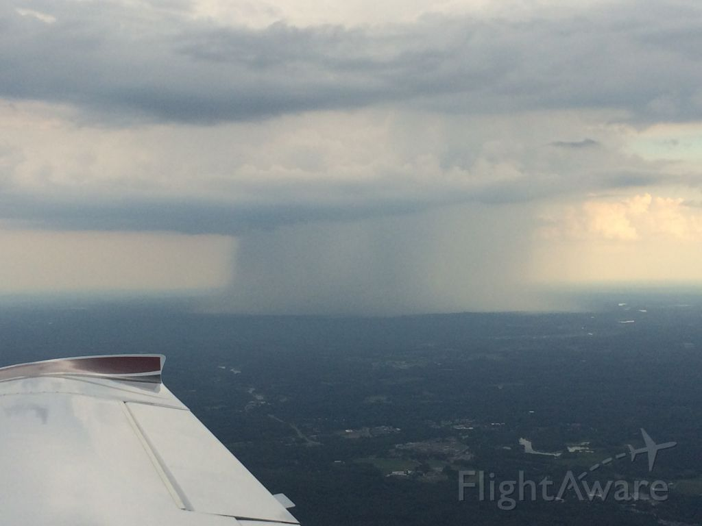 — — - Extreme precip over Boston on final to KLWM