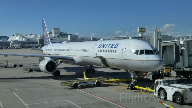 Boeing 757-200 (N859) - Brand new United B757-300 at Gate B42 KDEN, with the terminal in the background.