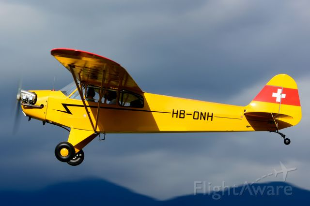 HB-ONH — - 1944 built former 44-80223 (USAF) leaving Piper Cub FlyIn 2014 quite colorful