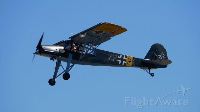 FIESELER Storch (N436FS) - SkyFair 7.21.18: #N436FS - Fieseler Storch F1-156-C2 / Ser #4362 making a pass over Rwy 34L.