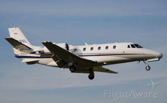 Cessna Citation Excel/XLS (ASP298) - Landing Buttonville runway 15 - ASP298 is Citation 560XL C-FBXL.