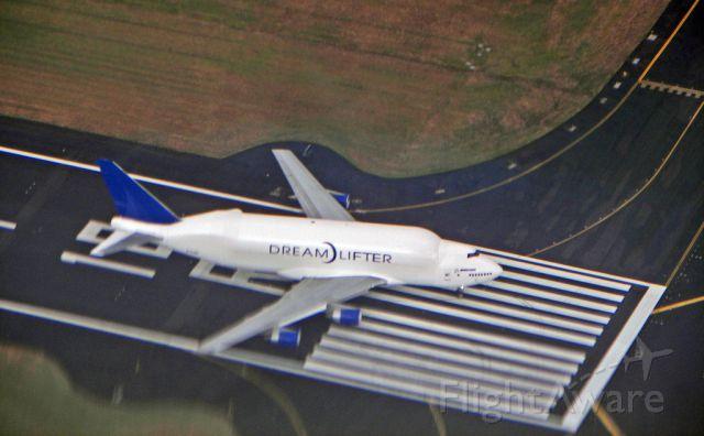 — — - Dreamlifter exiting the runway after landing at Portland International Airport.