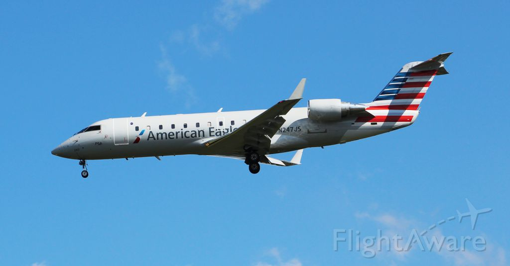 Canadair Regional Jet CRJ-200 (N247JS) - Blue Streak 5110 on short final for RW05 at Norfolk from CLT.