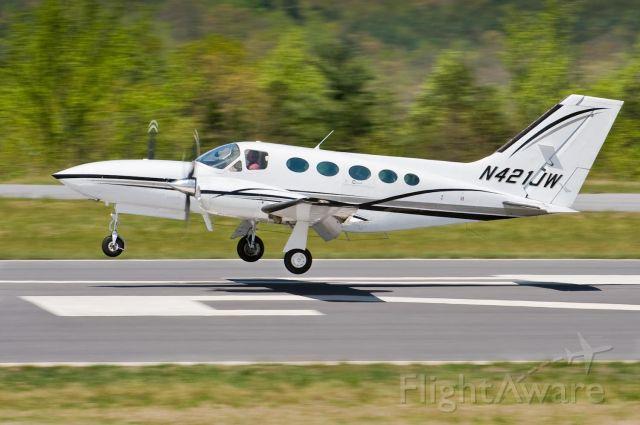 Cessna 421 (N421JW) - Landing on the 24 - 10.Apr.10