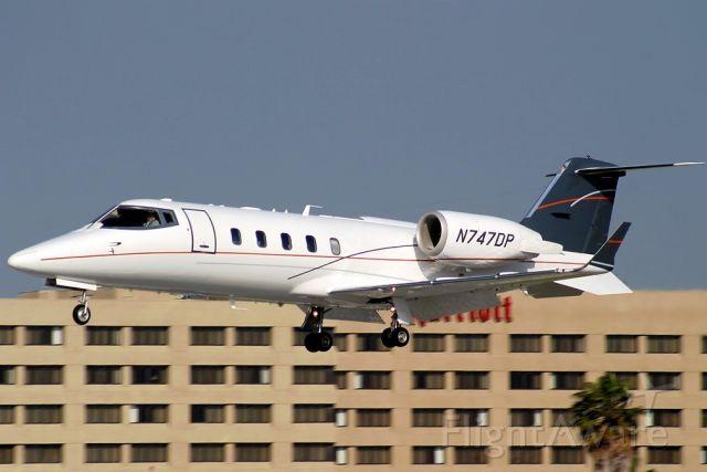 Learjet 60 (N747DP) - On final at LGB