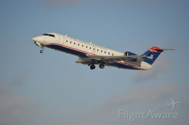 Canadair Regional Jet CRJ-200 (N248PS) - Thank you Kanawha County Schools for the 3rd SNOW DAY in a ROW!  I enjoyed spotting at CRW and playing with my new Nikon D3200!
