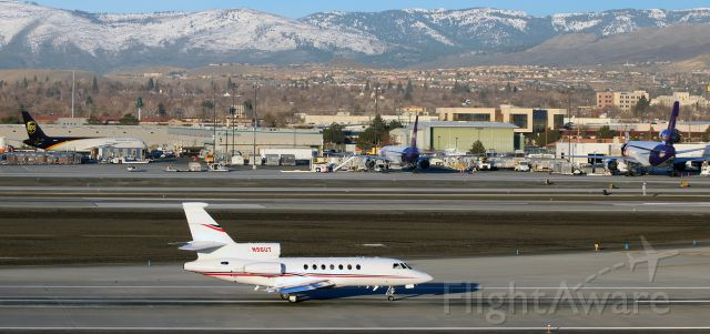 Dassault Falcon 50 (N96UT) - Backtaxiing down runway 16L at Reno Tahoe International, Democratic presidential candidate Hillary Clintons chartered Dassault Falcon 50 passes a pair of B757s and a DC-10 as it is about to make an early morning departure following Ms. Clintons overnight stay in Reno.