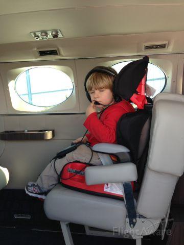 Cessna Chancellor (N414TN) - A happy passenger, making a request.