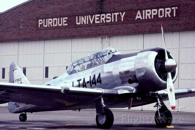 N55897 — - In front of the Purdue University hangar once used by Amelia Earhart.