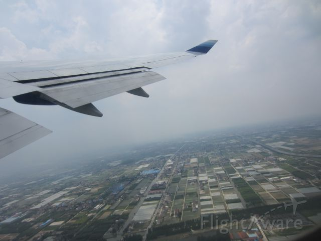 — — - Takeoff from Shanghai
