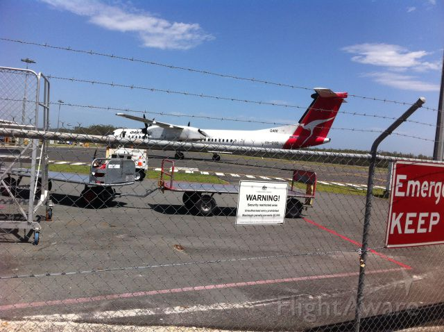 de Havilland Dash 8-400 (VH-QOD) - It was waiting for local papers. Port Macquarie must be the only Australian regional airport that gets Q400s, Q300s and Q200s from Q-link and ATR72s from VA