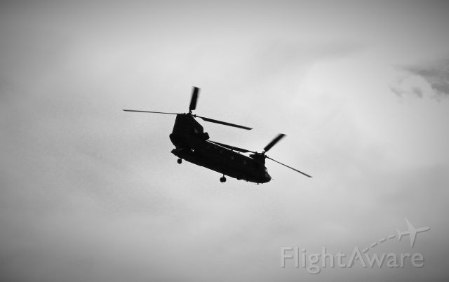 — — - Chinook flying over Pioneer Airport.