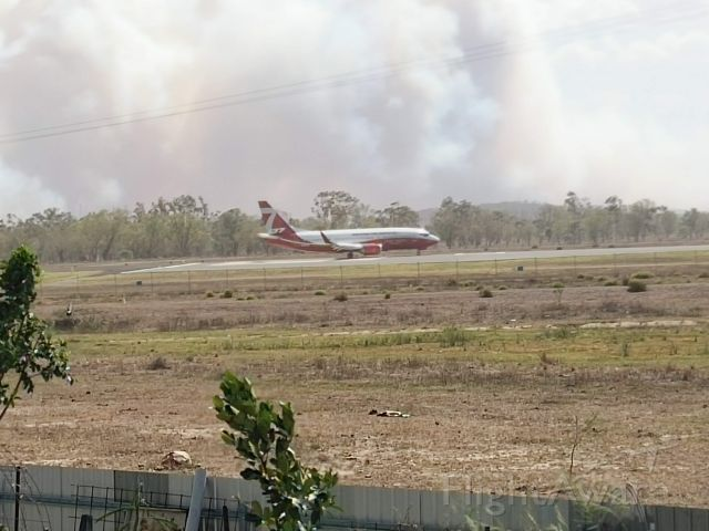 BOEING 737-300 (BMBR137) - About to takeoff runway 33 Rockhampton to save 8,000 people in Gracemere from being burnt out November 30, 2018. Note the thick smoke in the background from the bushfire.