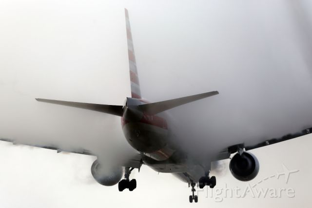 Boeing 777-200 — - AA B777-300ER, engulfed in condensation cloud, approaches runway 027L at LHR.