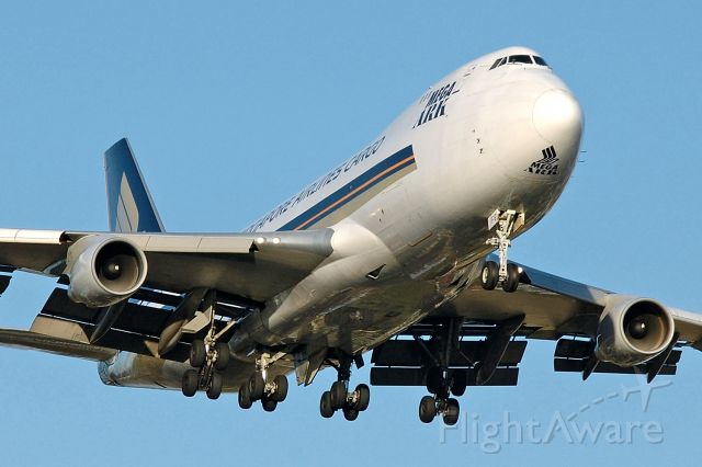 Boeing 747-400 (9V-SFG) - Adelaide, South Australia, November 27, 2007. On short final for Rw 23 at 1910.