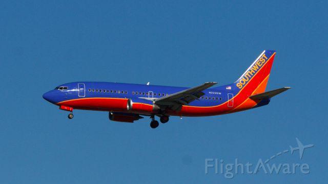 Boeing 737-700 (N333SW) - KHOU - KJAN on approach to Jackson-Evers International on 34L