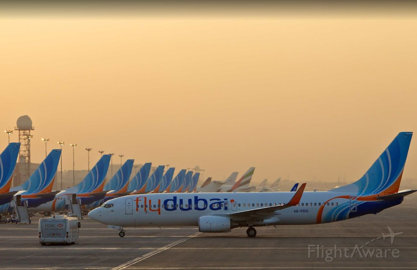 Boeing 737-800 (A6-FDO) - Arriving at dusk in Dubai to a packed terminal of Flydubai aircraft with another Flydubai 737