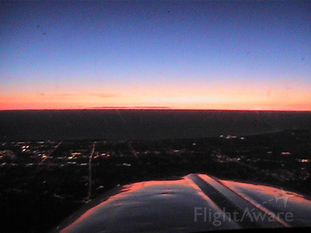 Beechcraft Bonanza (36) (N36BH) - Sunrise over MKE