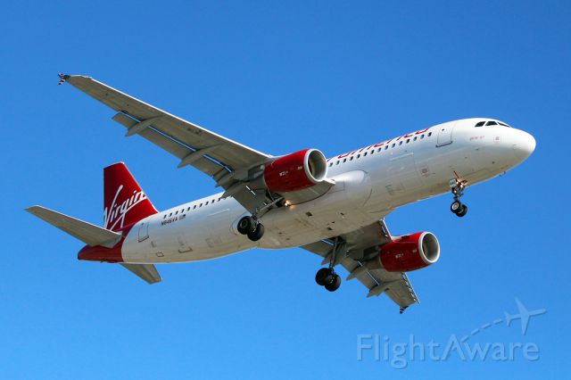Airbus A320 (N846VA) - Taken from the In-n-Out, short final for 24R, arriving from San Francisco