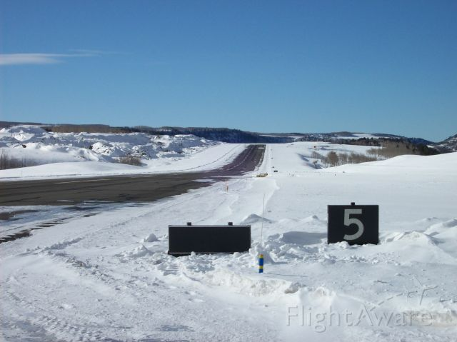 — — - Downhill?  Uphill?  Both!!!  Looking West down runway 27 at Telluride, CO.
