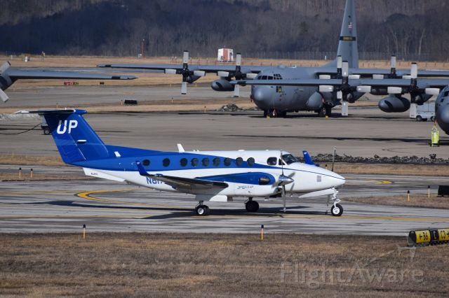 Beechcraft Super King Air 350 (N817UP) - Taxiing in front of WVANG 130th Airlift Wing at Yeager Airport (KCRW)
