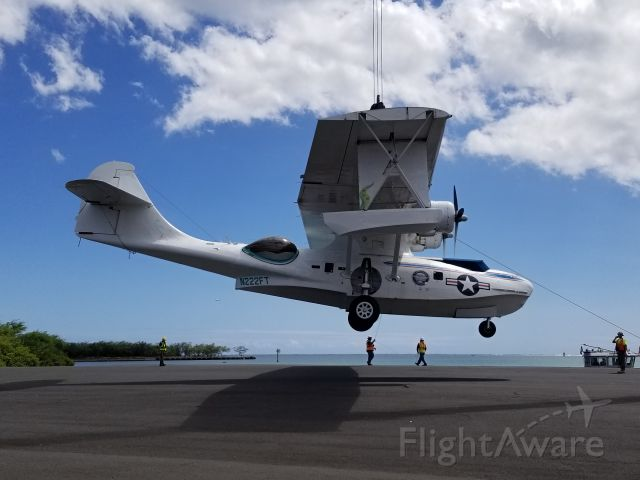 """N222FT — - A PBY5 gets great MPG as it """"flies"""" onto a barge before being shipped from O'ahu to the Mainland."""