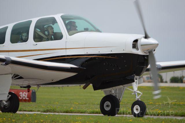 Beechcraft 35 Bonanza (N5EH) - Arriving early to Oshkosh 2013.