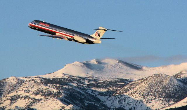 McDonnell Douglas MD-83 (N973TW) - The shadows and the golden glow of the scene easily reveal the time of day.  Just a few moments after sunrise, this MD-83 climbs away past Mt. Rose (just south of Reno Tahoe International) at the start of an early morning flight to KDFW.