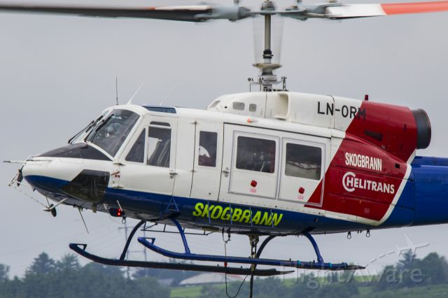 Bell BigLifter (LN-ORM) - Picture shot from my neighbors yard during a recovery operation by this Bell 214, they used it to lift out a crashed Cessna pontoon plane. Norway 2017