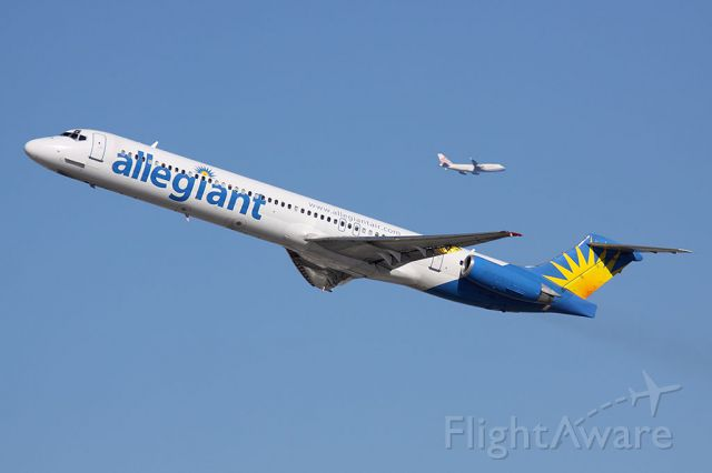 McDonnell Douglas MD-83 (N875GA) - Allegiant Air N875GA (FLT AAY328) climbing out from RWY 25R enroute to Rogue Valley Int'l (KMFR), with China Airlines on downwind.