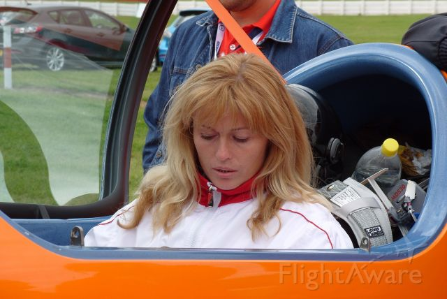 D-EPXA — - EGBV is Silverstone, England. Type is XtremeAir Sbach 300. Photo taken on 18AUG2009. c/n 007. Privately owned. Svetlana Kapanina of the Russian team at WAC 2009 in deep thought at the controls of the Xtreme Air Sbach 300 of the German team. She is not just a pretty face, she is a very accomplished pilot! She finished 11th in the Championship out of 58 competitors in her Sukhoi 26M3 registered RA-01059!