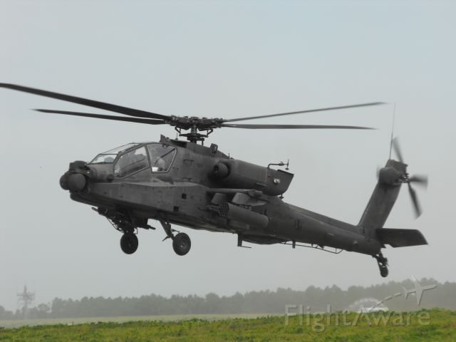 Boeing Longbow Apache (09-5605) - Another Apache lifting off from the helo pads