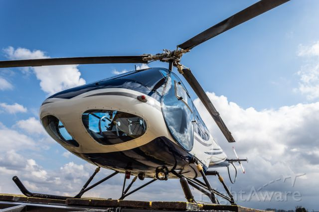 WUHAN 280 (N200EH) - An Enstrom F-28A sits on the pad at Warren County Airport.